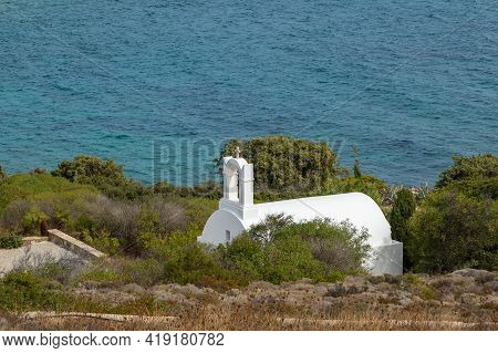 Traditional White Chapel. Aegean Sea In The Background. Antiparos Island, Greece.