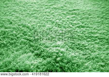 Bath Towel Texture With Blur Effect In Green Color. Abstract Background And Texture For Design.