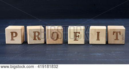 Wooden Cubes With The Inscription Profit. Profit Making Concept, Business Growth, Easy Money. Profit