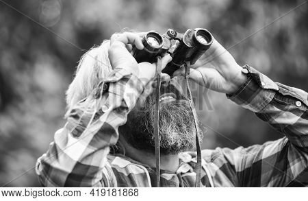 Tourists Man With Binoculars Looking For Something Along The Forest. Man With Binoculars Telescope I