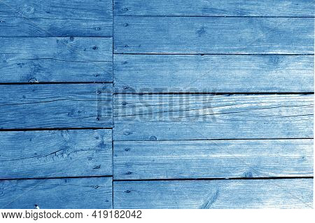 Wall Made Of Uncutted Weathered Wood Boards In Navy Blue Tone. Abstract Architectural Background And