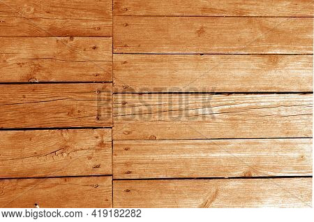 Wall Made Of Uncutted Weathered Wood Boards In Orange Tone. Abstract Architectural Background And Te