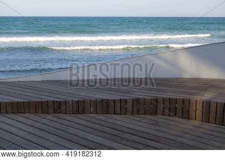 Wooden Pier Boardwalk And Sea View. Seasonal Natural Background.