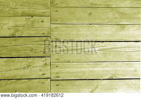 Wall Made Of Uncutted Weathered Wood Boards In Yellow Tone. Abstract Architectural Background And Te