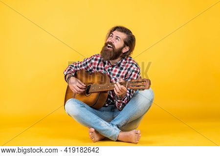 Fing The Melody. Play String Musical Instrument. Professional Caucasian Musician. Guitarist. Hipster