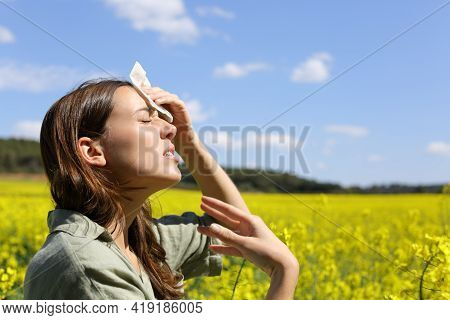 Side View Portrait Of A Stressed Woman Suffering Heat Stroke In Summer Vacation