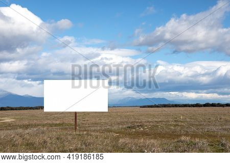 Blank cartel for advertising in the middle of the countryside
