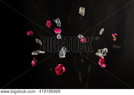 Glass Perfume Bottle Shatters And Bright Pink Flowers And A Spray Of Perfume Water Burst Out Of It O