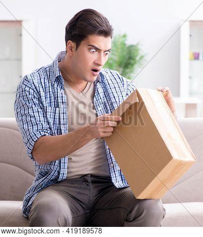Man receiving empty parcel with stolen goods