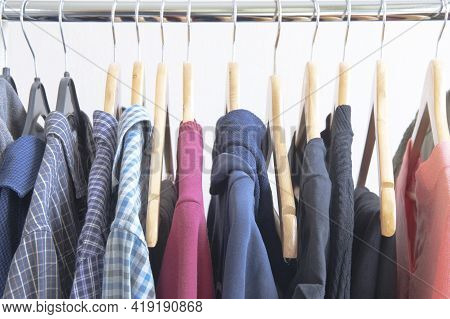 Soft Focus Image Of Men Clothes Hanging In The Wardrobe.