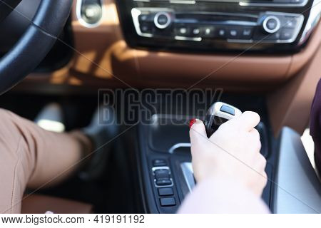 Woman Hand Holding Automatic Transmission Lever Closeup
