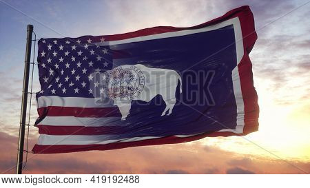 Wyoming And Usa Flag On Flagpole. Usa And Wyoming Mixed Flag Waving In Wind. 3d Rendering
