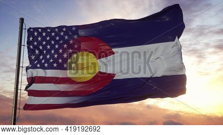 Colorado And Usa Flag On Flagpole. Usa And Colorado Mixed Flag Waving In Wind. 3d Rendering