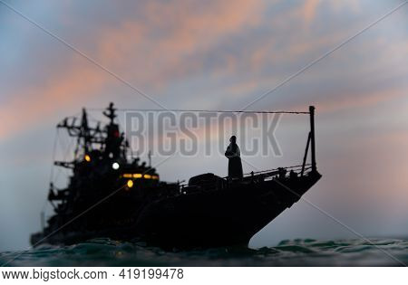 Silhouettes Of A Crowd Standing At Blurred Military War Ship On Foggy Background. Selective Focus.