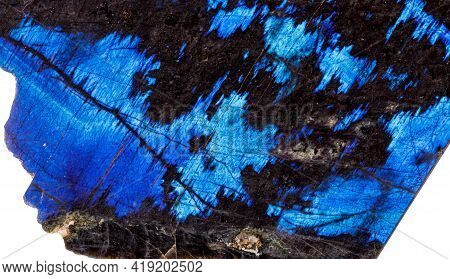 Macro Of A Stone Labradorite Mineral On A White Background Close Up