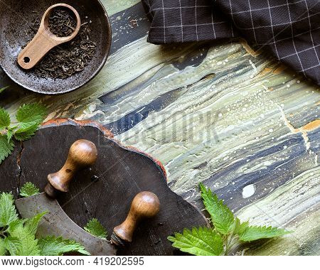 Stinging Nettle, Fresh Herbs, Herb Knife On Rustic Wooden Board. Dry Nettle Herb, Herbal Tea In Wood