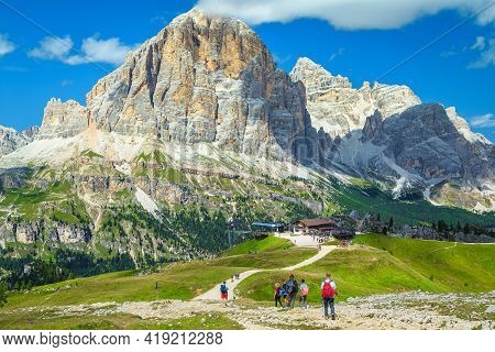 Sporty Backpacker Hikers On The Mountain Trails In The Dolomites. Active Tourists With Backpacks, Wa