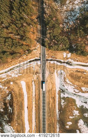 Aerial View Of Highway Road Through Spring Forest Landscape. Top View Of White Truck Tractor Unit Pr