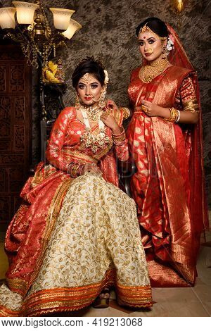 Magnificent Young Indian Brides In Luxurious Bridal Costume With Makeup And Heavy Jewellery With Cla