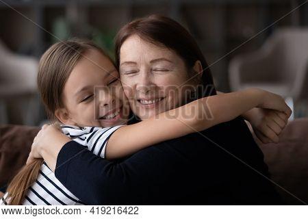 Happy Little Granddaughter Hug Elderly Granny Showing Love