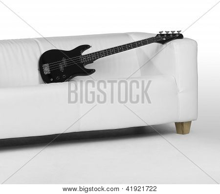 Black Bass Guitar On White Couch