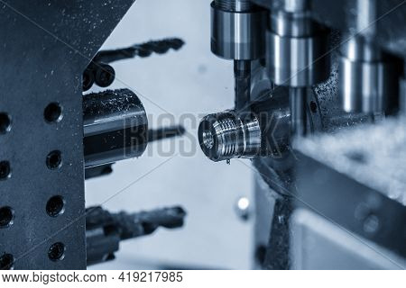 The  Operation Of Multi-tasking Cnc Lathe Machine Swiss Type Tapping On The Pipe Connector Parts. Th
