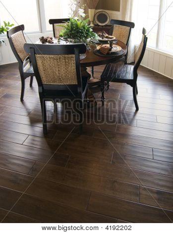 New Home Dinning Room With Dark Wood Flooring