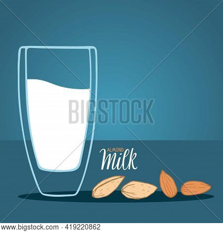 Almond Milk Glass And Almond Seeds Isolated On Blue Background With Inscription. Dairy Alternative M