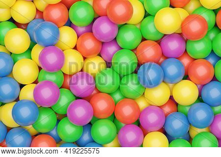 Ball Pool Or Pit Filled With Red, Green, Yellow, Pink And Blue Plastic Balls, Abstract Texture Backg