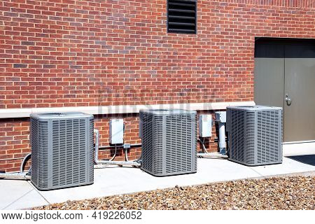 Three Brand New Hvac Outside Commercial Building