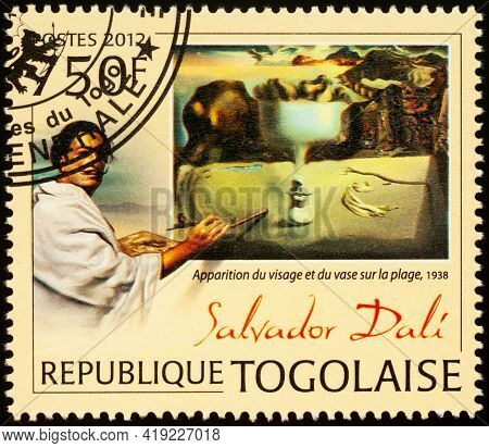 Moscow, Russia - May 03, 2021: Stamp Printed In Togo Shows Salvador Dali (1904-1989) And Painting Ap