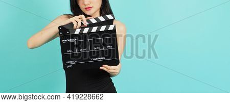 Black Clapper Board Or Movie Clapperboard In Woman Hand .it Use In Video Production ,film, Cinema In