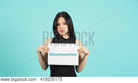 #stop Asian Hate Write In White Board Paper.asian Woman Holding Paper On White Background.