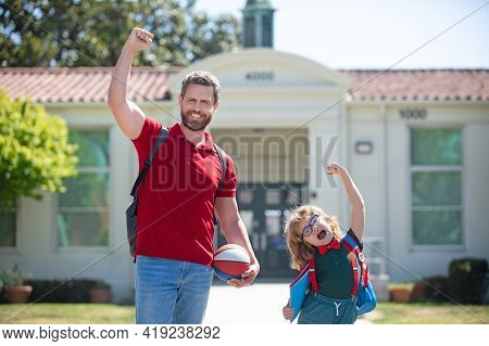 Father Supports And Motivates Son. Kid Going To Primary School.