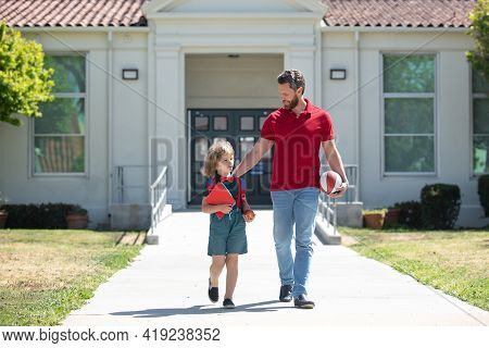 Outdoor School. School Boy Going To School With Father. Happy Dad And Son Go To Elementary School.