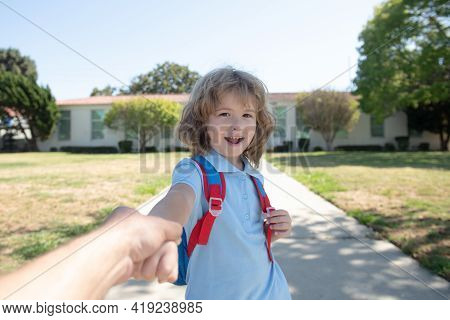 Pupil Holding Parent Fathers Hand Go To School. Beginning Of School Year. Beginning Of Lessons.