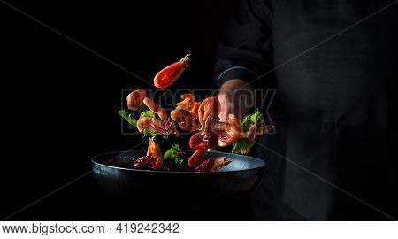 Professional Chef Prepares Shrimp With Herbs. Cooking Seafood, Healthy Vegetarian Food And Food On A