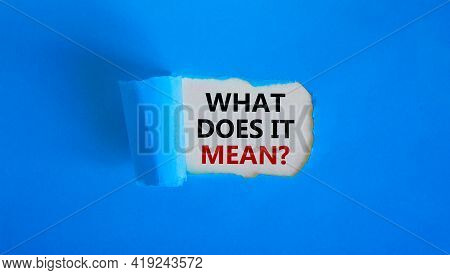 What Does It Mean Symbol. Concept Words 'what Does It Mean' Appearing Behind Torn Blue Paper. Beauti