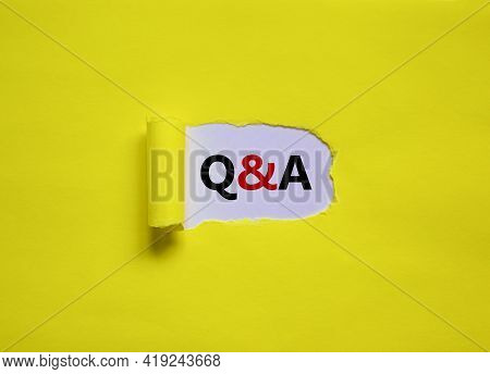 Question And Answer Symbol. Concept Words 'q And A - Question And Answer' Appearing Behind Torn Yell