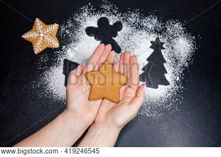 Step 5 Of 6. Composition Of Christmas Baking With Flour. Holding Gingerbread Cookie In The Shape Of