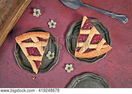 Slices Of Pie Called 'linzer Torte', A Traditional Austrian Shortcake Pastry Topped With Fruit Prese