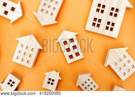 Many Miniature Wooden Houses. Real Estate Concept. Buying And Selling Housing. Rent. Mortgage Rates.