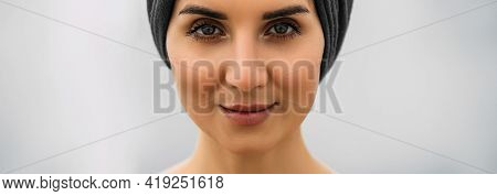 Beautiful Female Look Close Up. Panoramic Shot. Close-up Photo Of Beautiful Female Brown Eyes. Portr