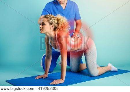Girl Performs Exercises With A Physiotherapist. Cyan Background