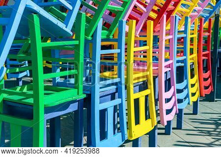 Colored Chairs Composed In Non-working Period, A Street Outdoor Cafe