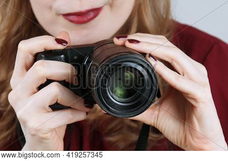 Woman Photographer Holding Small Digital Camera To Take Pictures For Various Projects Shot Behind Le