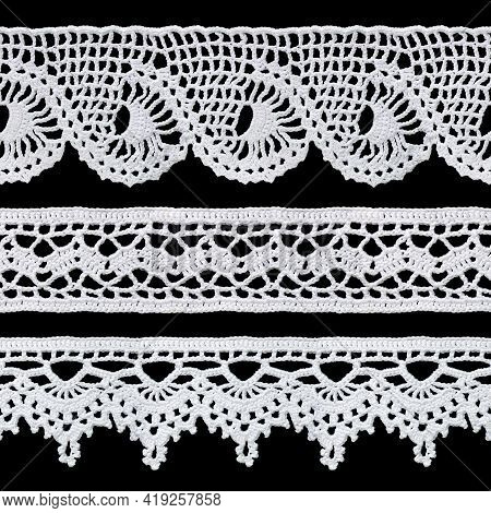 Set Of White Tape Lace On A Black Background. The Lace Is Crocheted By Hand. Vintage Style. Material