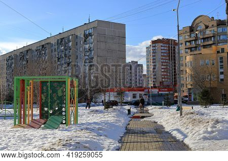 Balashikha, Russia - March 19, 2021. Residential Neighborhood In The Spring. Old Children Playground