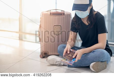 Asian Woman Wearing Surgical Mask Feeling Sad And Depress For Missed Or Cancelled Flight For Aboard
