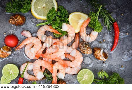 Shrimp Peeled On Dark Background For Cooking, Fresh Shrimps Or Prawns Seafood And Shellfish With Her